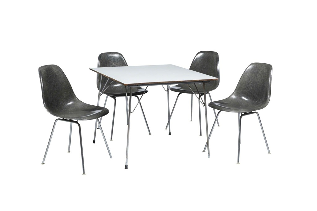 Charles Eames   A chromed metal table with a wood and formica top ...