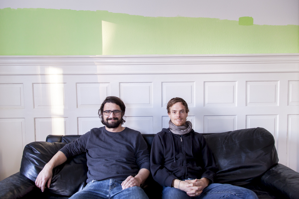 Portrait of hosts, in the background work by Federico Herrero