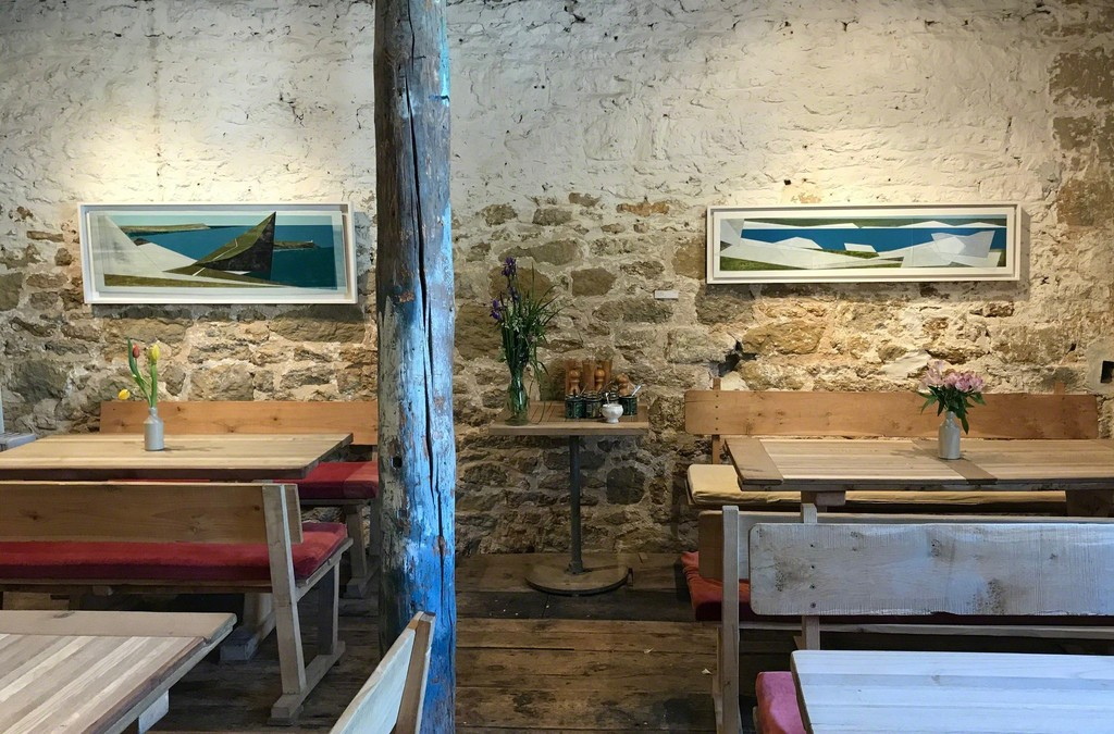 Winged Coast 1 and Quarry Edge 24 look fantastic in our Café. Their long landscape shape fits brilliantly above furniture like windows to a sea view.