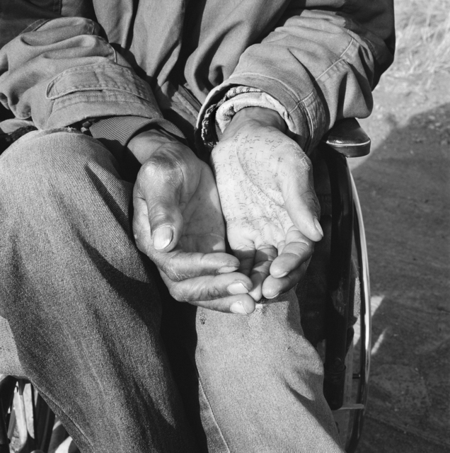 , 'Crippled by a stray bullet from an argument in which he had no part, a former gold-miner sits in a wheelchair and begs at a crossroad on the Johannesburg-Cape Town highway, while pursuing winning numbers for the national lottery. Springsfontein. 7 August 2003,' 2003, Goodman Gallery