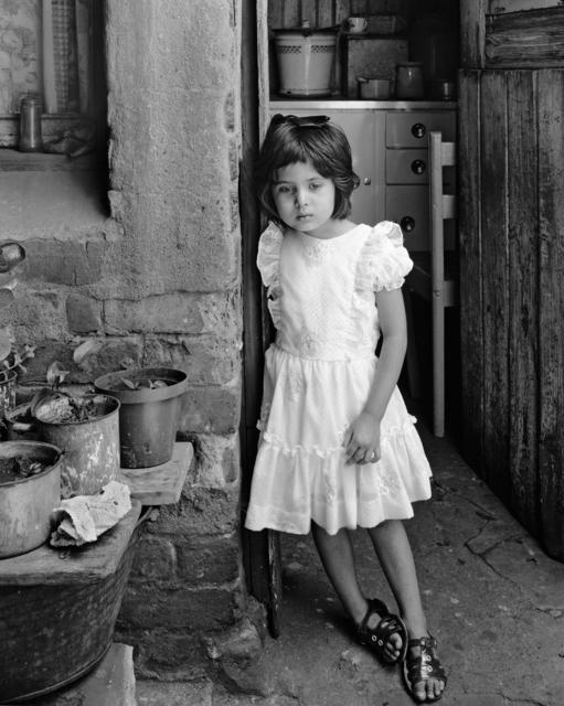 , 'Yasmin at kitchen door of Miss Tahera Karbelkar, Kause Street, Fietas, Johannesburg. December 1976,' 1976, Goodman Gallery