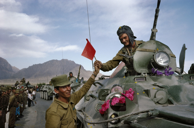 , 'Afghan soldier hands red solidarity flag to Soviet officer,' 2010, Photography Collections Preservation Project
