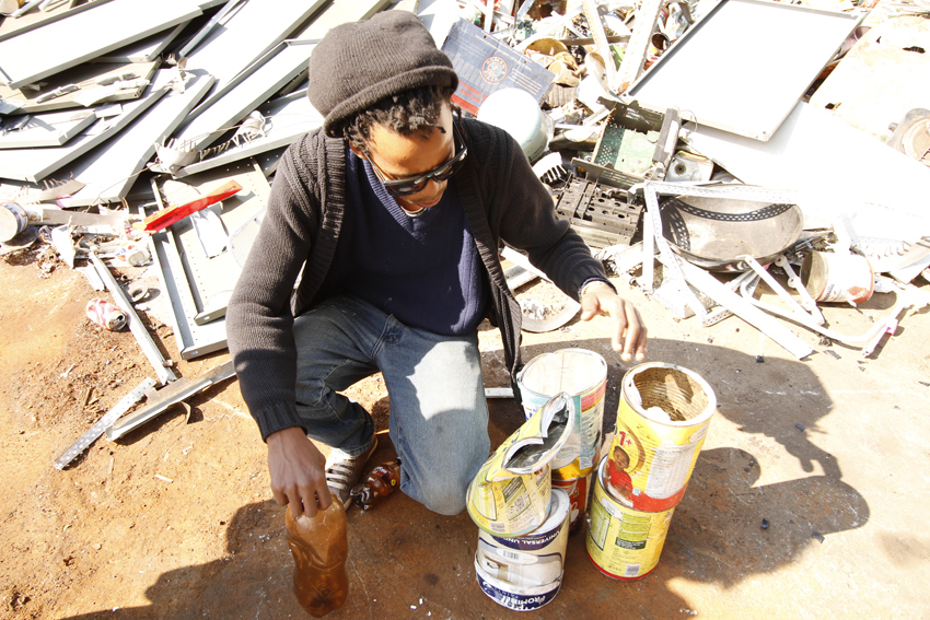 Thabo Pitso at the Scrapyard picking material for his sculptures.