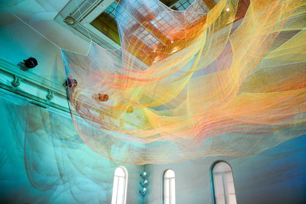 Janet Echelman, 1.8 Renwick, 2015, knotted and braided fiber with programmable lighting and wind movement above printed textile flooring, Smithsonian American Art Museum, photo by Tony Powell