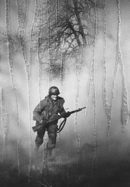 , 'American GI Ivan Parrott is seen running through smoke in no man's land near Neuss, Germany during the Battle for the Rhine, World War II, 1st March 1945,' , Monroe Gallery of Photography