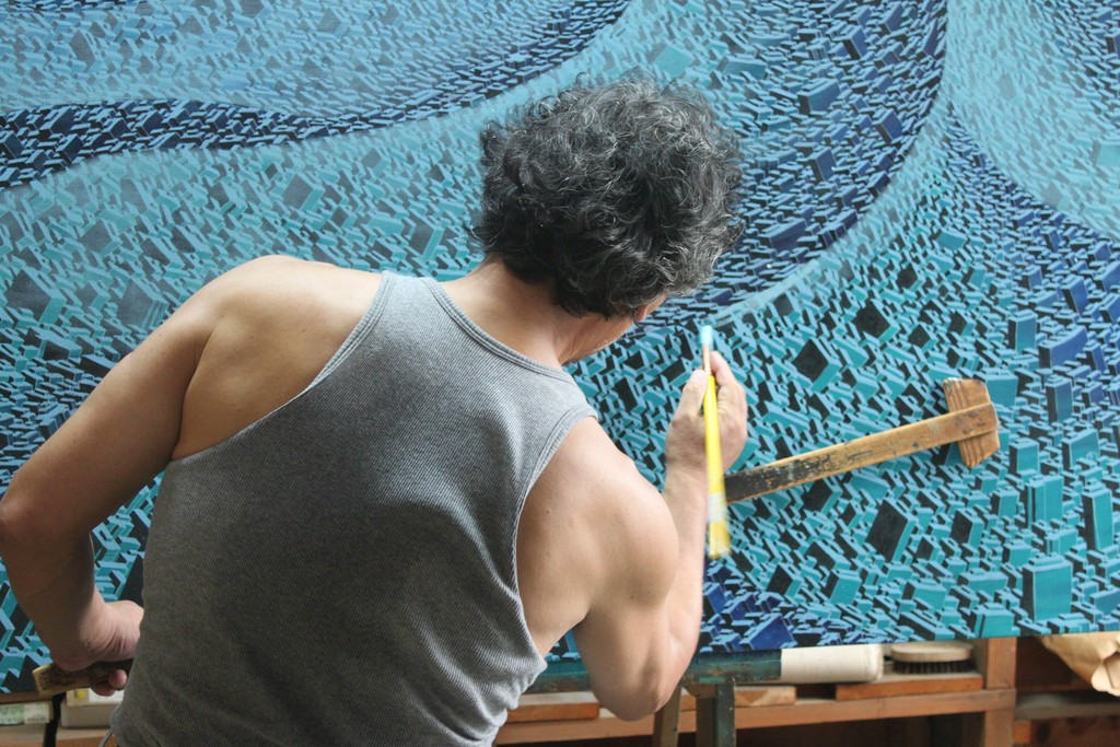 The artist Satoshi Koyama in action creating one of the very large oil paintings in his Life City Series.