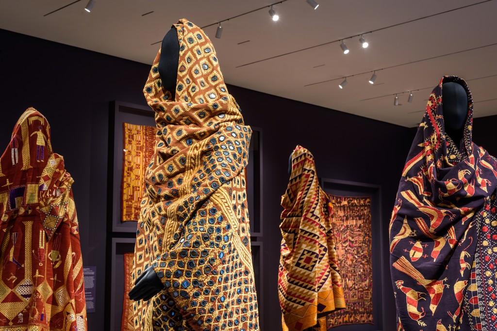 "Installation Photograph of ""Phulkari: The Embroidered Textiles of Punjab from the Jill and Sheldon Bonovitz Collection"" Courtesy of the Philadelphia Museum of Art."