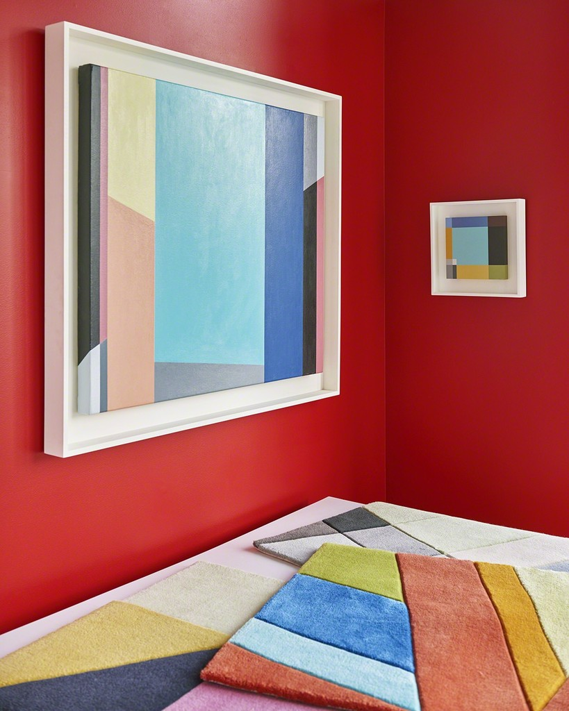 Musicology hand on a red wall. The smaller painting, Plaid, picks up, but also absorbs, some of the color of the larger piece. On the flat files are samples of the Art Rugs.