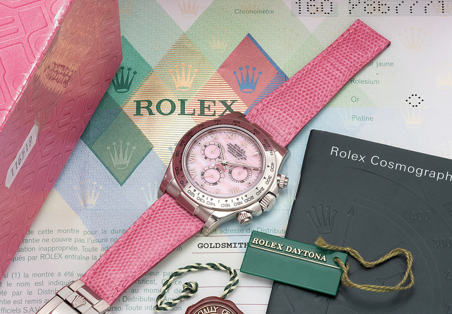 Rolex, 'A fine, unusual and very attractive white gold automatic chronograph wristwatch with pink mother-of-pearl dial, guarantee and box', Circa 2002, Phillips