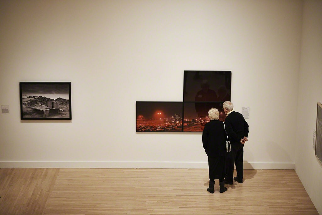 "Guests taking a closer look at Lewis Baltz's 1989 work ""Piazza Sigmund Freud"" at the Fall 2017 Open House.