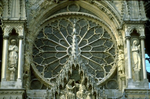 'Reims Cathedral: exterior, West facade, detail of rose window and gable over central portal (Coronation of the Virgin)', ca. 1211-1290, Allan Kohl