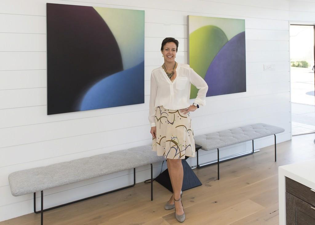 Esperanza Leon, curator, with Maria Schon paintings