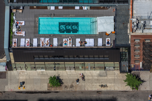 ", 'The Sixty LES Hotel, at 190 Allen Street, boasts an ""Andy Warhol filmstrip pool"" on the roof.,' 2014, Anastasia Photo"