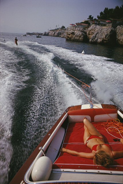 , 'Leisure in Antibes, 1969: A woman sunbathes on a motorboat as it tows a waterskier in the bay off the Eden-Roc,' 1969, Staley-Wise Gallery