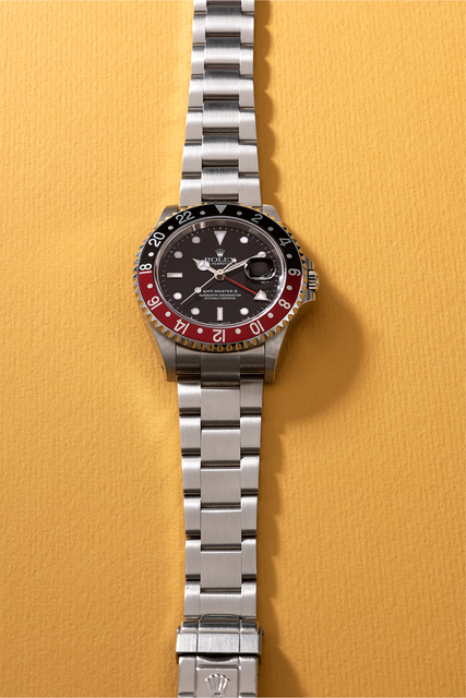 Rolex, 'An attractive stainless steel dual time wristwatch with date, sweep center seconds, bracelet, guarantee, hang tags and box', Circa 2000, Phillips