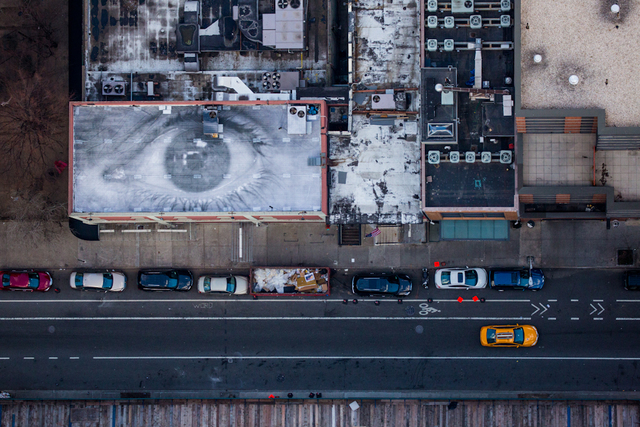 , 'A photographic installation by the artist JR adorns the roof of a building used to tape The Colbert Report on West 54th Street.,' 2014, Anastasia Photo