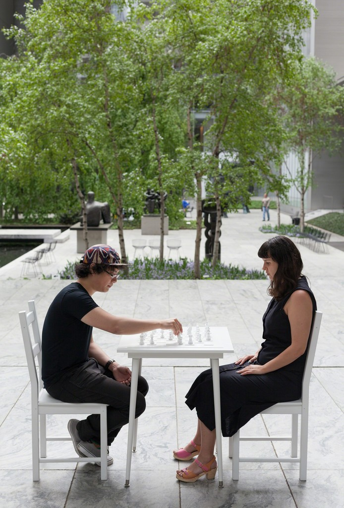 Yoko Ono's White Chess Set (1966) in the Abby Aldrich Rockefeller Sculpture Garden, presented in conjunction with Yoko Ono: One Woman Show, 1960-1971, The Museum of Modern Art, New York, May 17–September 7, 2015. © 2015 The Museum of Modern Art. Photo: Thomas Griesel.