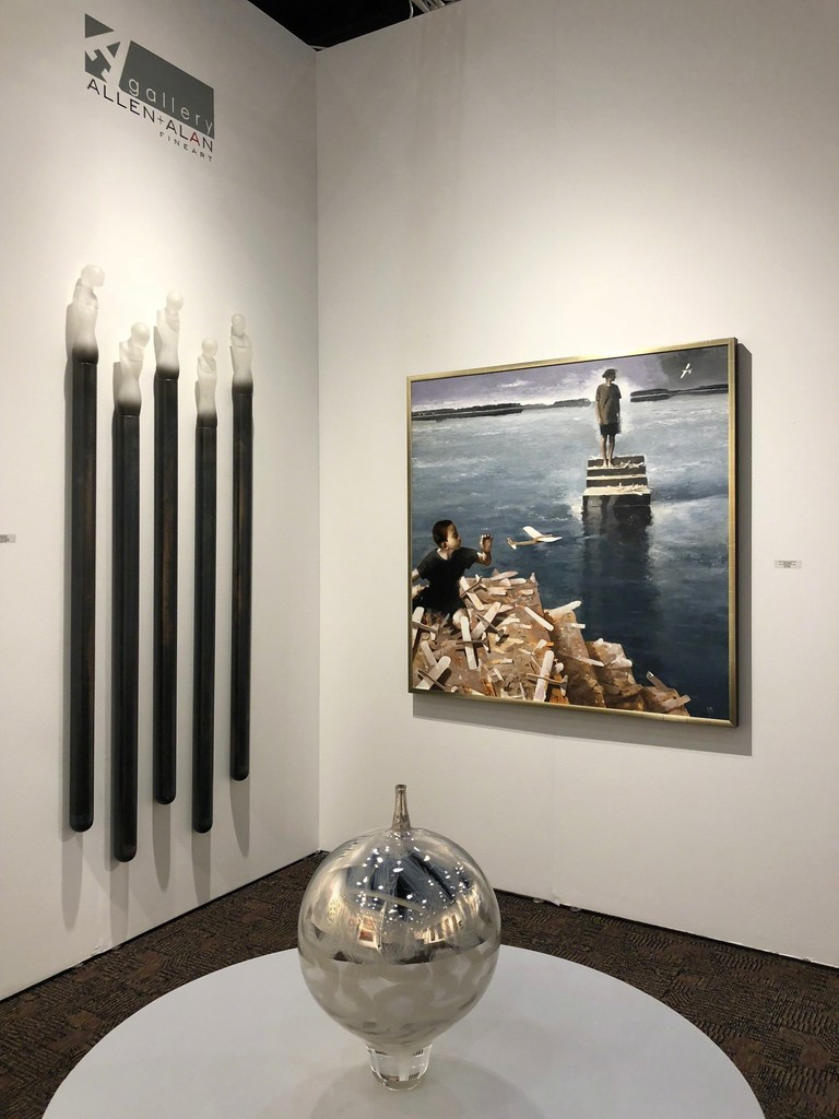 "Seth Fairweather's cast glass figures, ""Industrial Ascetics"" and mirrored glass bowl work beautifully with Gary Ruddell's painting, ""Where Words Can Not Be Heard"" Booth 413"