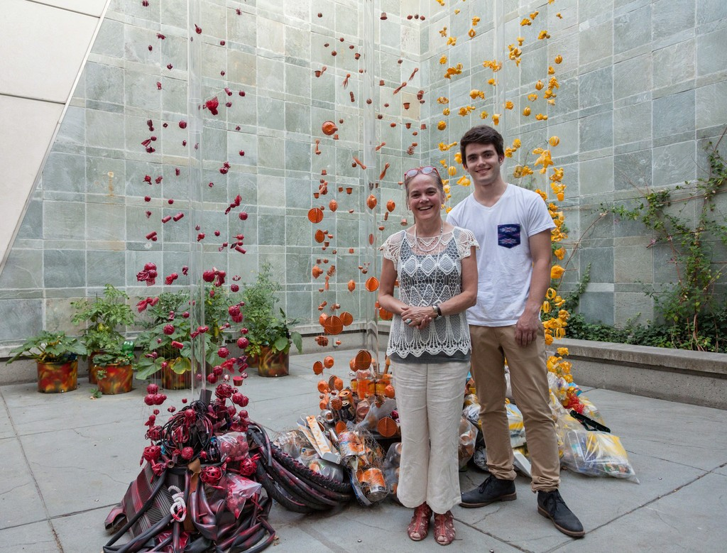 "Max Sterry and Carolina Sanchez de Bustamante in front of the ""PIECES OF WHAT"" art installation."