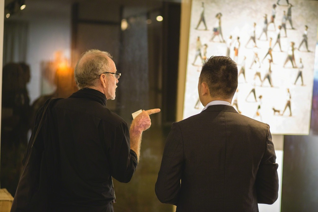 Guest interacting with gallery co-founder, Weiren Loh, on finer aspects of Didier Lourenço's artworks.