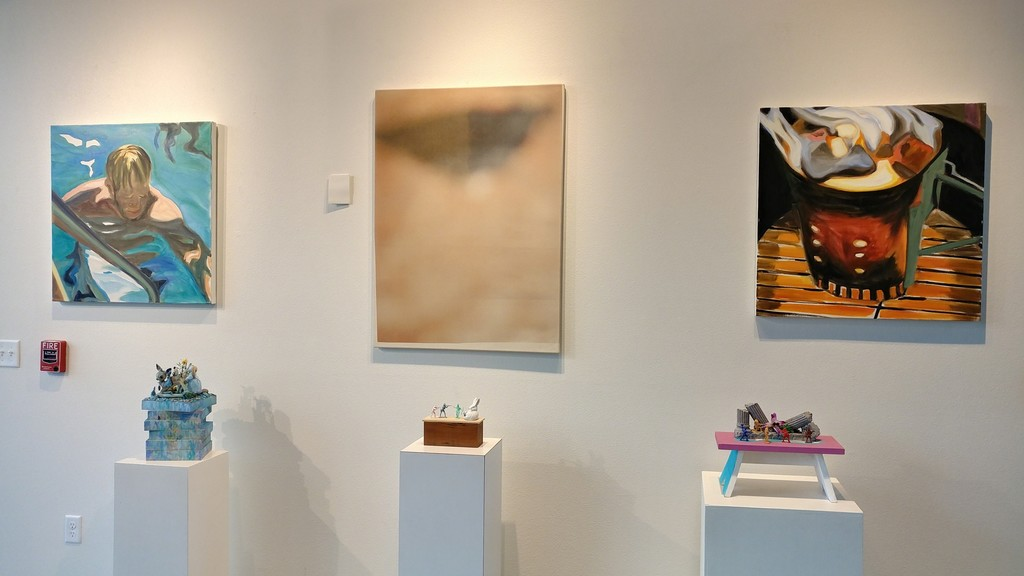Paintings by Douglas Degges (center) and Maureen O'Leary (left, right), and sculptures by Rita Bard