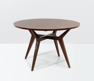a table with a wooden structure and metal details