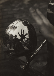 Self-Portrait in Reflection of Car Headlight