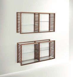 a bookcase with two wall shelves