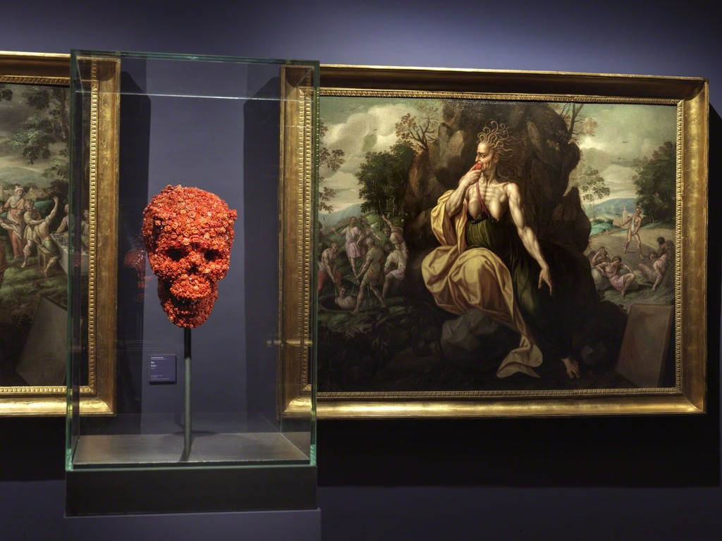 """The Devilish Love for Death"", one of the works of the the triptych of coral sculptures composed also by  ""The Devilish Passion"" and ""The Devilish Bridge between Life and Dead"", 2019, deep precious coral, pigment, polymere. In the background ""Envy"" by Jacques de Backer from the series ""The Seven Deadly Sins"", Farnese Collection."