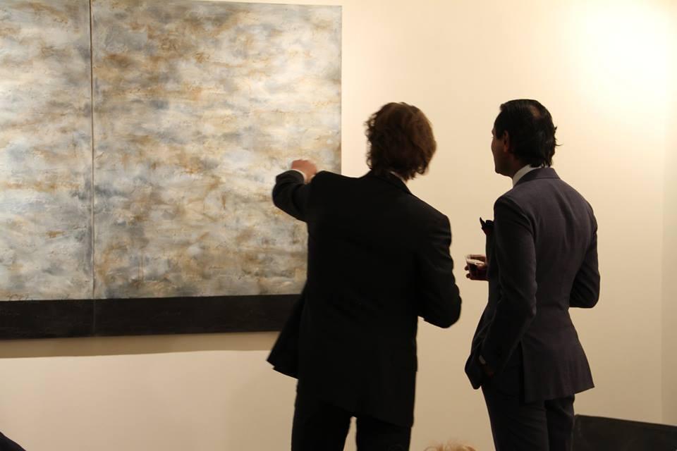 Opening attendees admiring Alfredo Rapetti Mogol's Mappa del Mio Cielo
