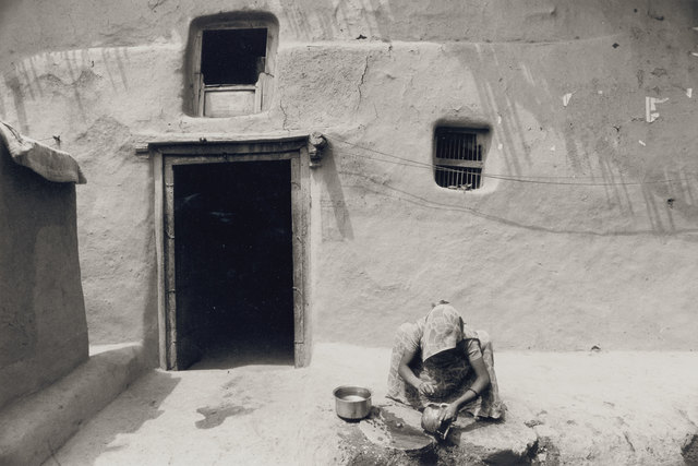 , 'A Woman in Front of a Stuccoed House in the Village of Rangwasa,' 1977-79, Prahlad Bubbar