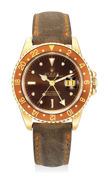 """Rolex, 'A fine and rare yellow gold dual-time wristwatch with """"nipple dial"""", sweep center seconds and date', Circa 1980, Phillips"""