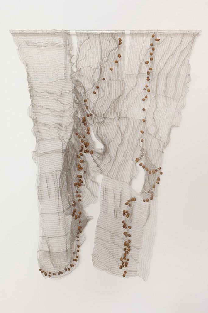 Naomi Wanjiku Gakunga Encino 2010 stainless Steel wire and acorns 181 x 87cm Photo Jonathan Greet Image courtesy October Gallery London