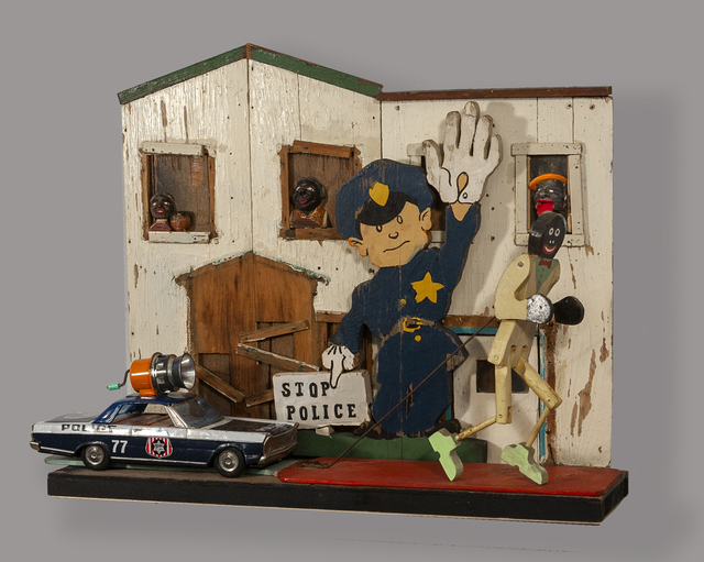 Kat Flyn, 'Stop Police', 2020, Sculpture, Assemblage sculpture: handmade deconstructed wood toy house facade, old wood racist stereotype dancing toy with paddle,vintage tin police car No 77 (South-Central Los Angeles) with broken siren (makes noise), handmade & painted wood policeman cutout, hand carved wood face in window., Jonathan Ferrara Gallery