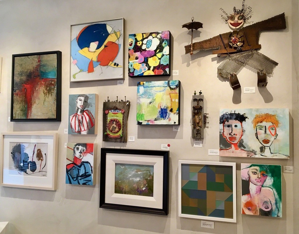 Grouping of small paintings and wall sculptures.