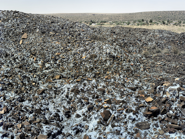 , 'Highly carcinogenic blue asbestos waste on the Owendale Asbestos Mine tailings dump, near Postmasburg, Northern Cape. The prevailing wind was in the direction of the mine officals' houses at right. 21 December 2002,' 2002, Goodman Gallery