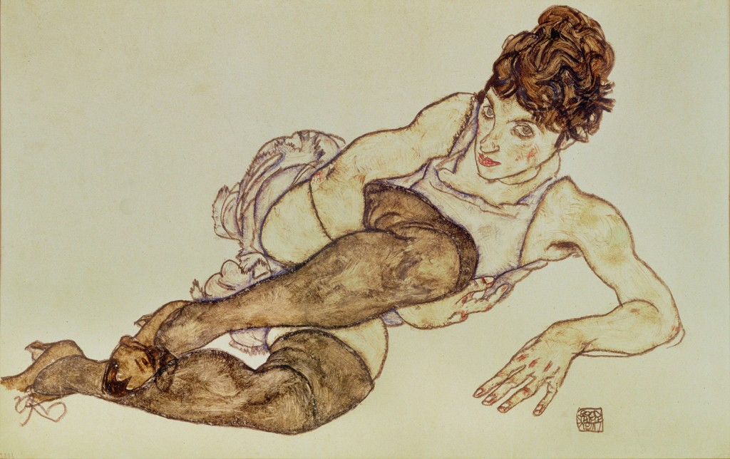 Reclining woman with black stockings
