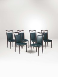 Six chairs with a wooden structure and skai upholstery