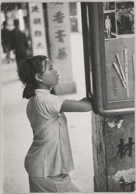 , 'Looking at photos of the Hong Kong beauty queen display in a window,' 1952, Magnum Photos