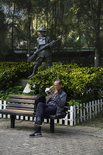 , 'Man reading on a bench in Hong Kong, China,' 2014, Asia Society Hong Kong