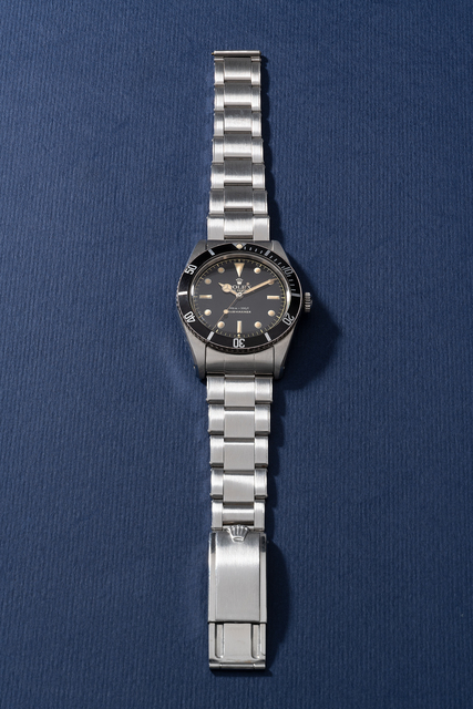 """Rolex, 'An extremely attractive and rare stainless steel wristwatch with center seconds, no crown guards, """"exclamation mark"""" black glossy dial and bracelet', Circa 1962, Phillips"""