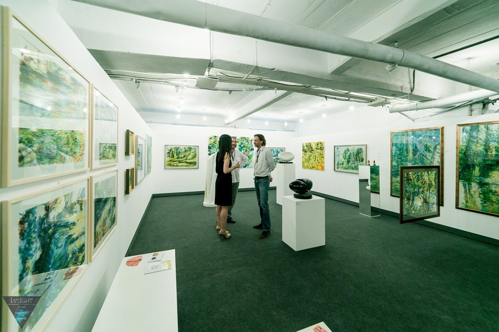 Artfooly Gallery booth at International Contemporary Art Fair Art Safari Bucharest, 2015. Painter Claudiu Presecan, curator Anca Negescu, sculptor Dan Istrate.