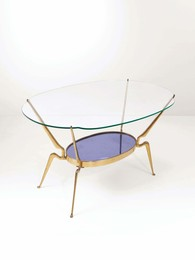 A table with a brass structure, one top in cut glass, the other in cut and mirrored coloured glass