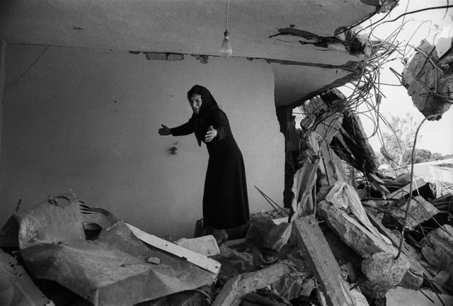 Don McCullin, 'A Palestinian woman returning to the ruins of her house, Sabra, Beirut', 1982, Howard Greenberg Gallery