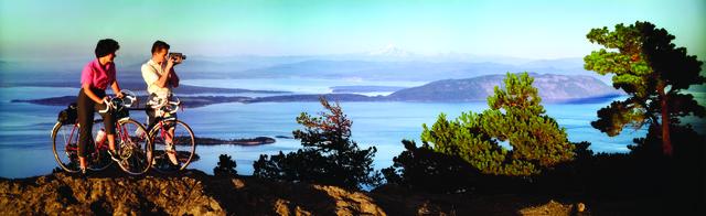 , 'Colorama 244,Mountain Bikers, Olympia National Park & Strait of San Juan De Fuca, Washington,' Displayed 9/14/64–10/5/64, George Eastman Museum