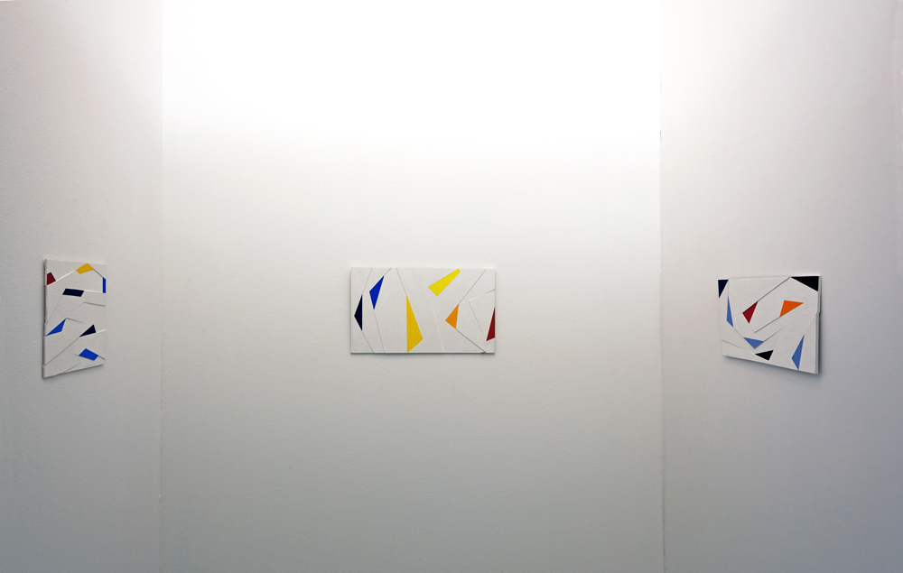 View into the exhibition with 3 paintings using triangular forms; photo: Thomas Prochnow