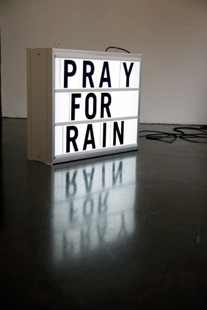 Installation for solo exhibition 'There is Anarchy in our Midst' with 'Pray For Rain' lightbox.