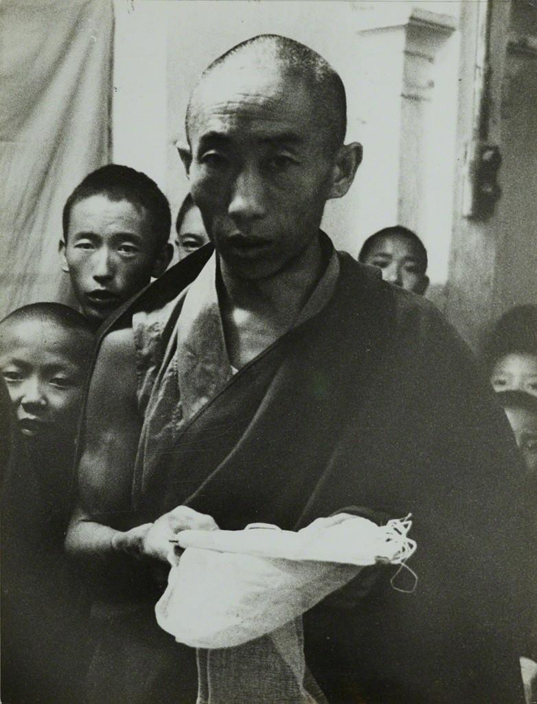 Tibetan religious ceremony offering of the white scarf