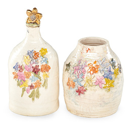 Vase and stoppered bottle with flowers, California