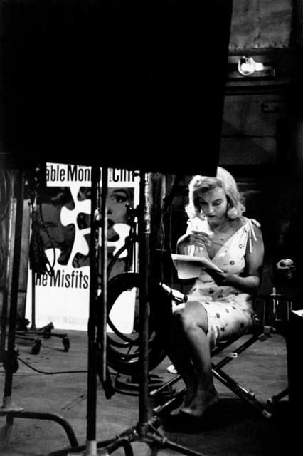 , 'Marilyn Monroe looking at layouts for posters to advertise the Misfits. Nevada, USA. ,' 1960, Magnum Photos